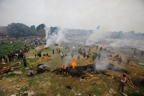 Hundred of funeral pyres were started throughout the cities and countryside to provide mass cremation of the victims. Photo - Agence France-Presse