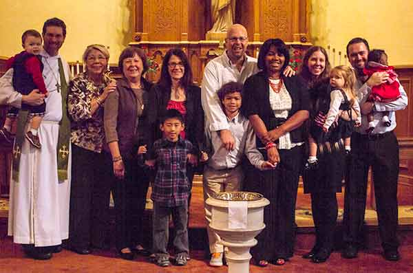 Three families were at Trinity to receive grants to help defray the cost of their adoptions.
