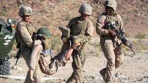 soldiers rescuing fallen comrade