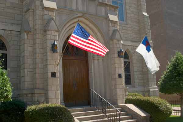 American flag flies outside Trinity's front door