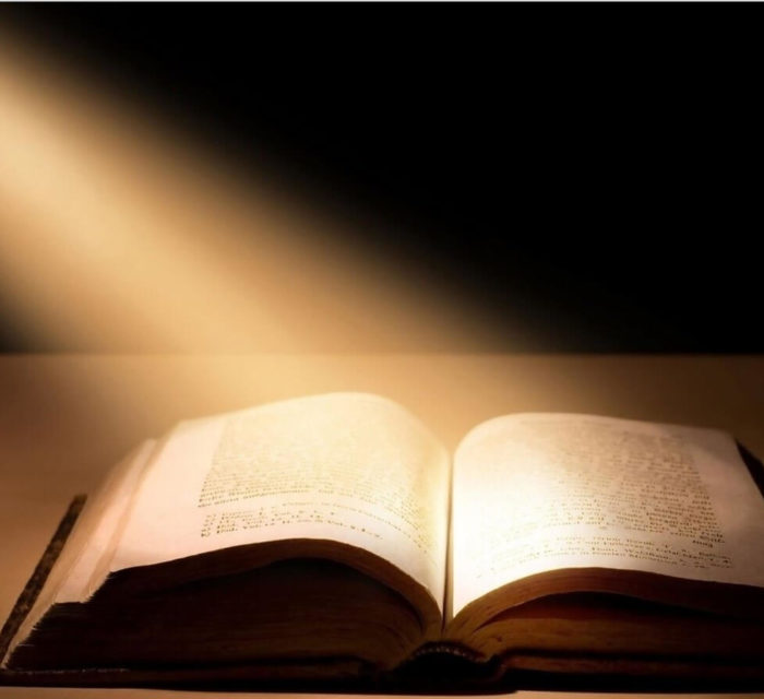 Bible illuminated by light